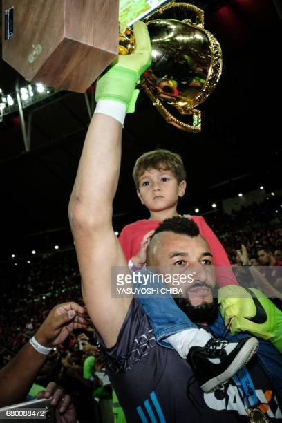 Alex Muralha of Brazil's Flamengo holds the champions cup after winning against Fluminense the Copa Carioca football match at Maracana stadium in Rio...
