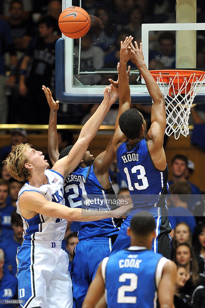 Alex Murphy #12, Amile Jefferson #21 and Rodney Hood #13 of the Duke Blue Devils go up for a rebound during Countdown to Craziness at Cameron Indoor Stadium on October 19, 2012 in Durham, North Carolina.