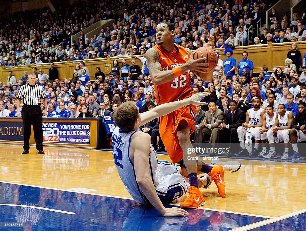 Alex Murphy #12 of the Duke Blue Devils draws a blocking foul as he defends a drive by K.J. McDaniels #32 of the Clemson Tigers during play at Cameron Indoor Stadium on January 8, 2013 in Durham, North Carolina.