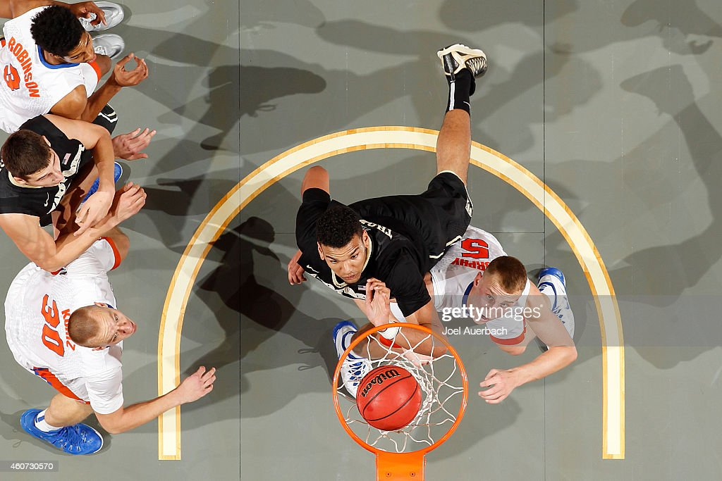 Alex Murphy of the Florida Gators looks up as Devin Thomas of the Wake Forest Demon Deacons scores a basket during the MetroPCS Orange Bowl...