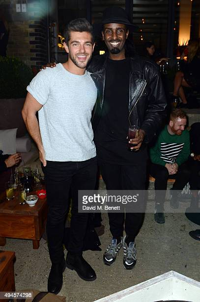 Alex Mytton and Mason Smillie attend the launch of Wringer Mangle bar and restaurant on October 27 2015 in London England