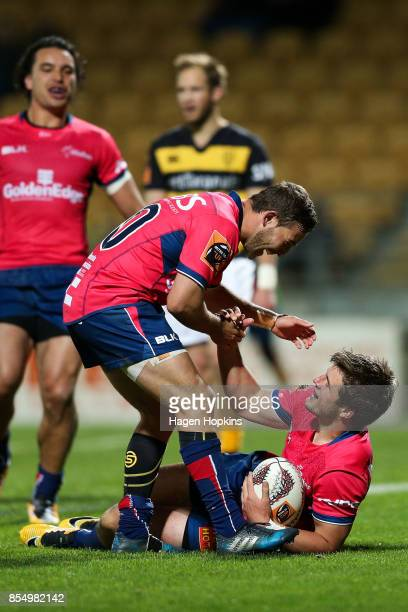 Alex Nankivell of Tasman celebrates after scoring a try with teammate Mitchell Hunt during the round seven Mitre 10 Cup match between Taranaki and...