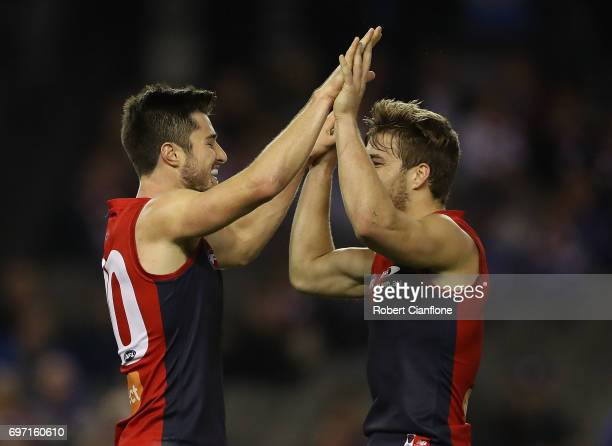 Alex NealBullen of the Demons celebrates with Jack Viney after scoring a goal during the round 13 AFL match between the Western Bulldogs and the...
