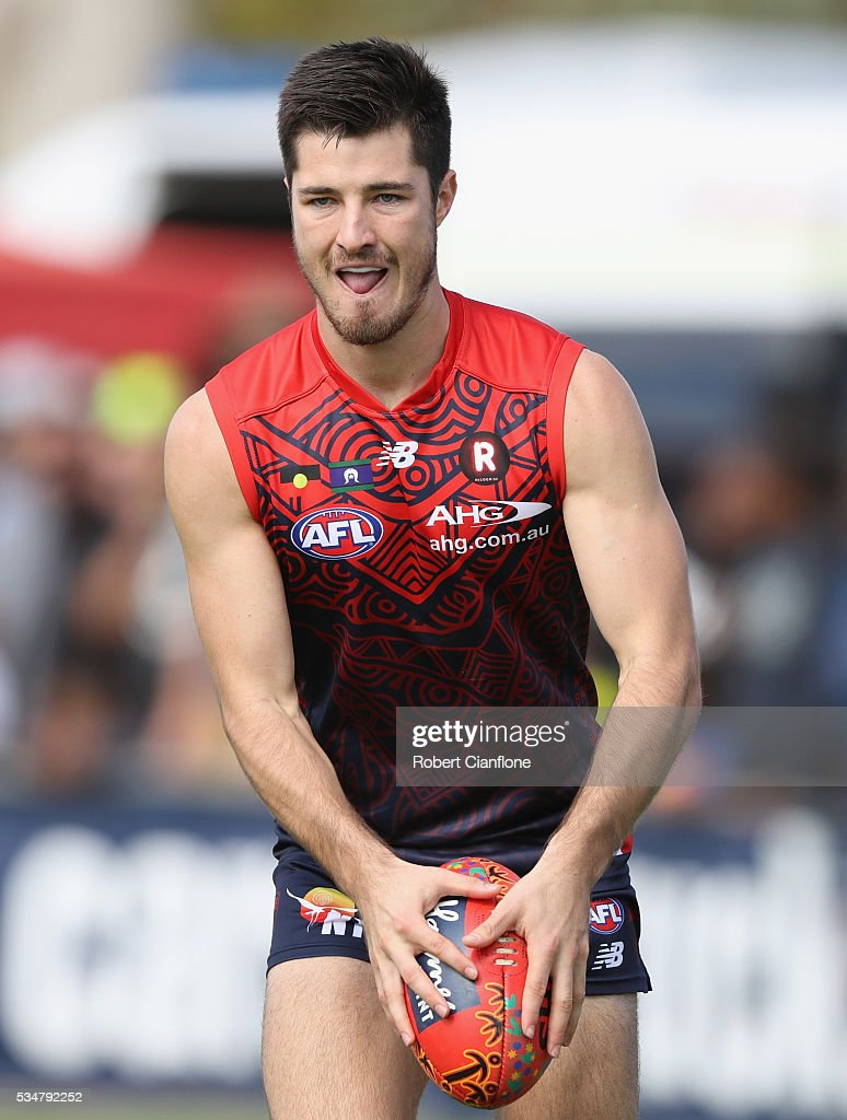 Alex Neal-Bullen of the Demons controls the ball during the round 10 AFL match between the Melbourne Demons and the Port Adelaide Power at Traeger Park on May 28, 2016 in Alice Springs, Australia.