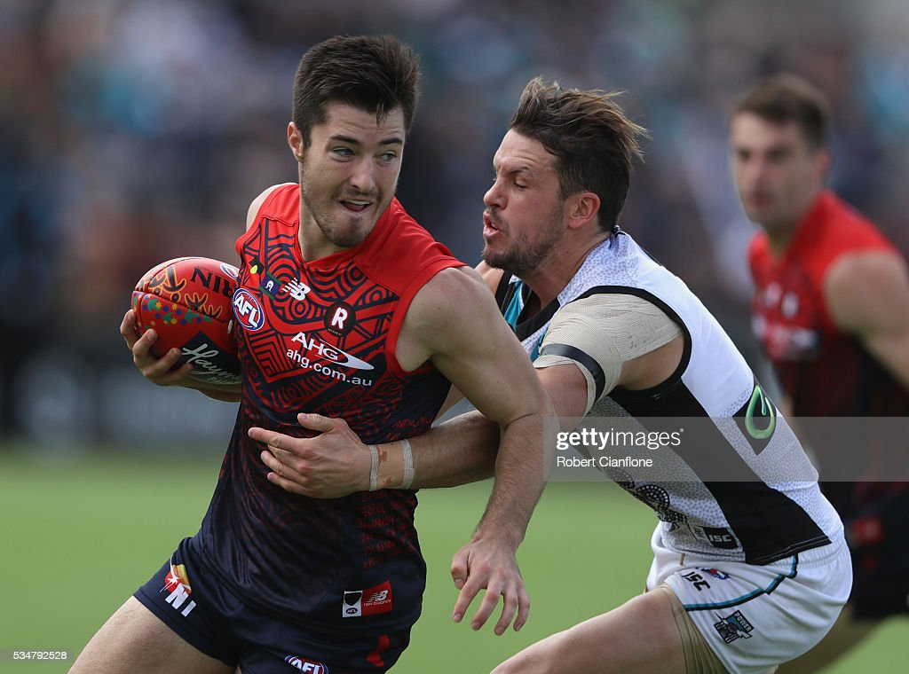 Alex Neal-Bullen of the Demons is challenged by Travis Boak of Port Adelaide during the round 10 AFL match between the Melbourne Demons and the Port Adelaide Power at Traeger Park on May 28, 2016 in Alice Springs, Australia.