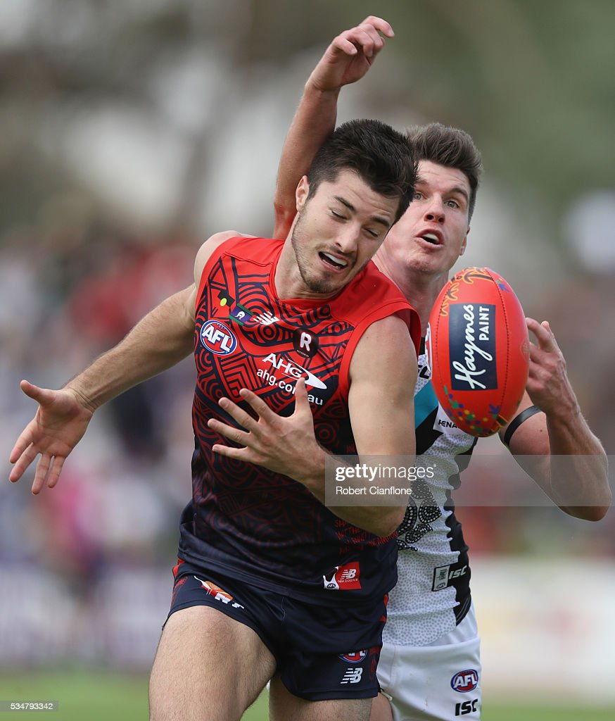 Alex Neal-Bullen of the Demons looks to control the ball during the round 10 AFL match between the Melbourne Demons and the Port Adelaide Power at Traeger Park on May 28, 2016 in Alice Springs, Australia.