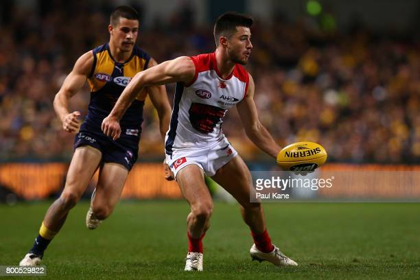 Alex NealBullen of the Demons looks to handball during the round 14 AFL match between the West Coast Eagles and the Melbourne Demons at Domain...