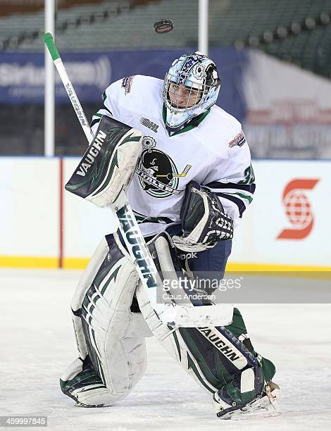 Alex Nedeljkovic of the Plymouth Whalers takes a shot high on the shoulder against the London Knights during Game Two of the OHL Winter Classic at...