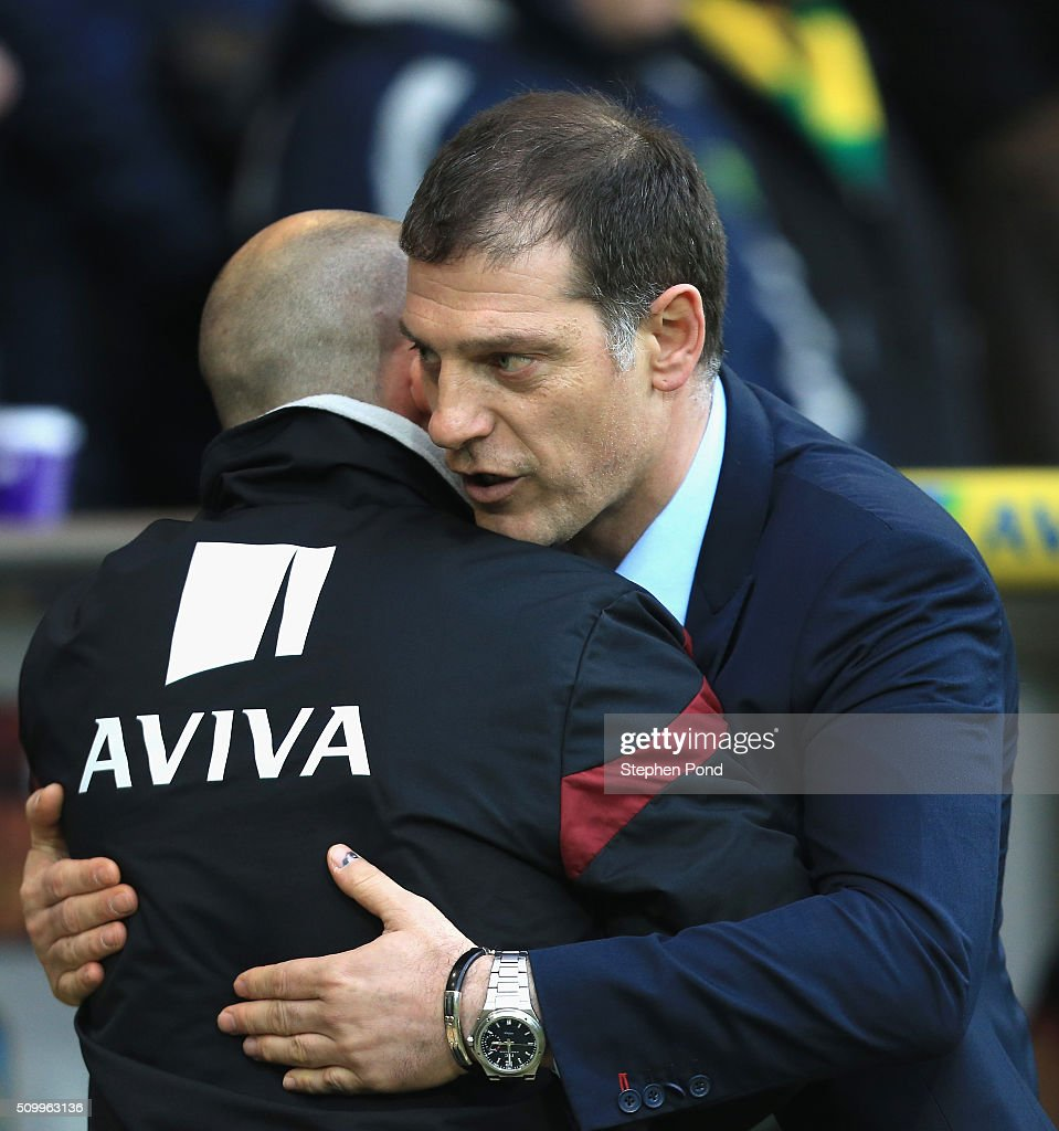 <a gi-track='captionPersonalityLinkClicked' href=/galleries/search?phrase=Alex+Neil+-+Soccer+Manager&family=editorial&specificpeople=14644952 ng-click='$event.stopPropagation()'>Alex Neil</a> Manager of Norwich City and <a gi-track='captionPersonalityLinkClicked' href=/galleries/search?phrase=Slaven+Bilic&family=editorial&specificpeople=1040506 ng-click='$event.stopPropagation()'>Slaven Bilic</a> manager of West Ham United greet prior to the Barclays Premier League match between Norwich City and West Ham United at Carrow Road on February 13, 2016 in Norwich, England.