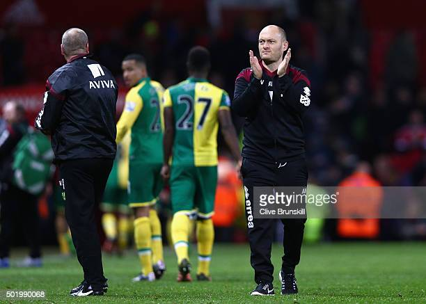 Alex Neil Manager of Norwich City applauds supporters after his team's 21 win in the Barclays Premier League match between Manchester United and...
