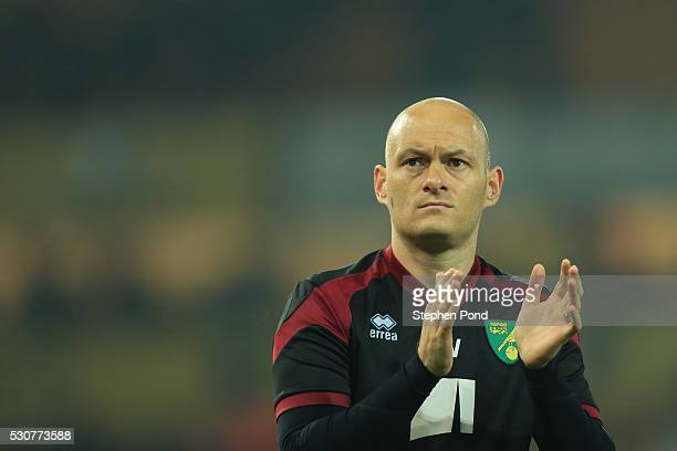 Alex Neil manager of Norwich City applauds the fans after his side were relegated during the Barclays Premier League match between Norwich City and...