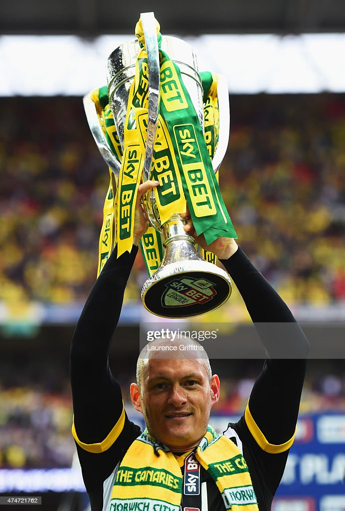 Alex Neil manager of Norwich City celebrates with the trophy after the Sky Bet Championship Playoff Final between Middlesbrough and Norwich City at Wembley Stadium on May 25, 2015 in London, England. Norwich City seal promotion to the Premier League with a 2-0 victory