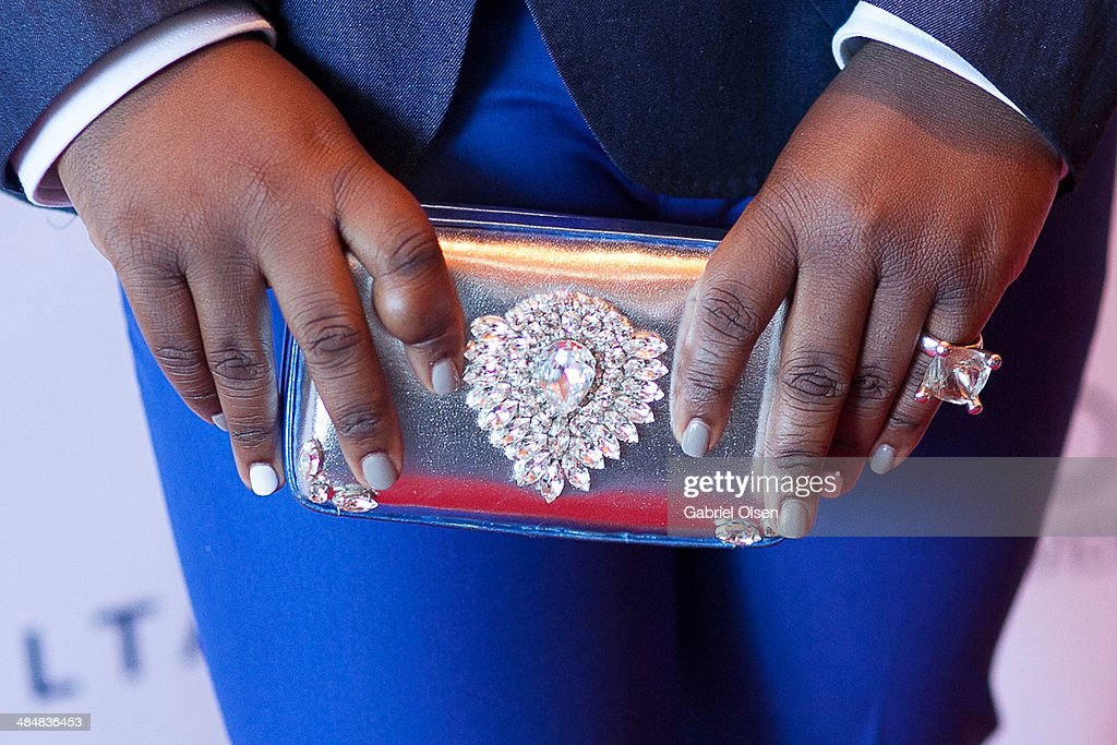 Alex Newell (purse detail) arrives to the 25th Annual GLAAD Media Awards - Dinner and Show on April 12, 2014 in Los Angeles, California.