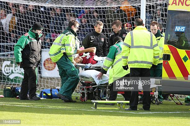 Alex Nicholls of Northampton Town in distress after suffering a broken leg while scoring his sides 1st goal during the npower League Two match...