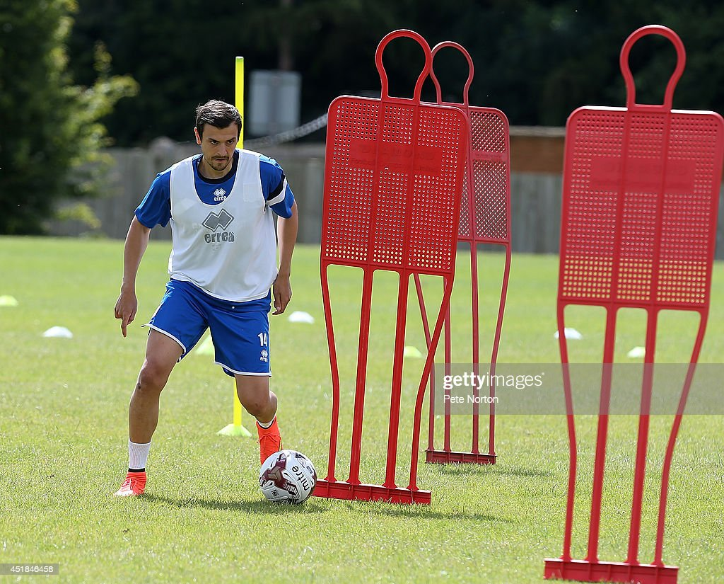 Alex Nicholls of Northampton Town moves with the ball during a training session at Moulton College on July 8, 2014 in Northampton, United Kingdom.