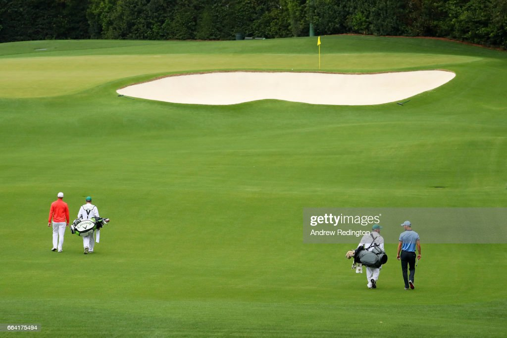 Alex Noren of Sweden and Martin Kaymer of Germany walk down the fourth hole with their caddies during a practice round prior to the start of the 2017 Masters Tournament at Augusta National Golf Club on April 3, 2017 in Augusta, Georgia.