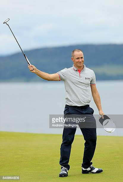 Alex Noren of Sweden celebrates after claiming victory on the 18th green during the final round of the AAM Scottish Open at Castle Stuart Golf Links...
