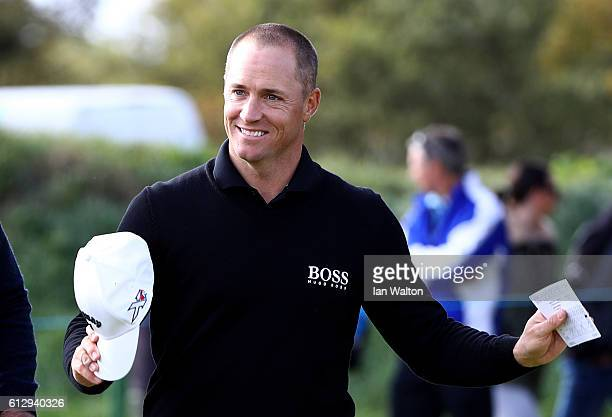 Alex Noren of Sweden celebrates after finishing his round on the nineth green during the first round of the Alfred Dunhill Links Championship on the...