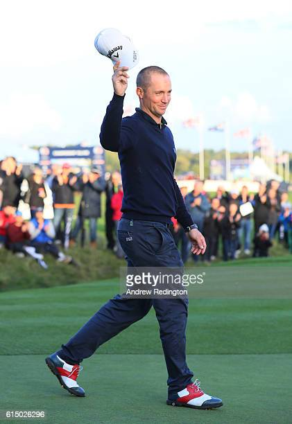 Alex Noren of Sweden celebrates on the 18th green following his victory during the fourth round of the British Masters at The Grove on October 16...