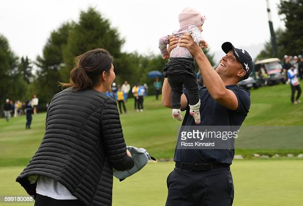 Alex Noren of Sweden celebrates victory with his after sinking a long putt on the the first extra hole during the final round of the Omega European...