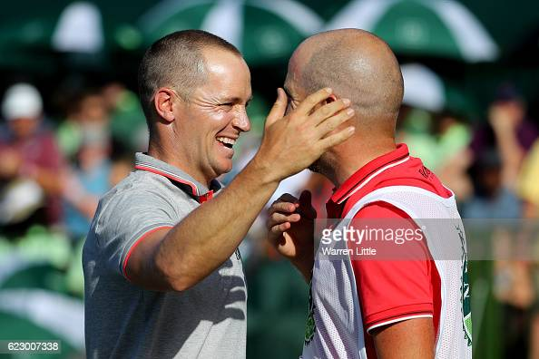 Alex Noren of Sweden celebrates with caddie Lee Warne after his victory on the 18th green during day four of the Nedbank Golf Challenge at Gary...