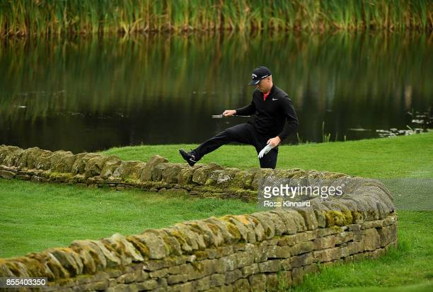 Alex Noren of Sweden climbs over a wall on to the 14th green during day two of the British Masters at Close House Golf Club on September 29 2017 in...