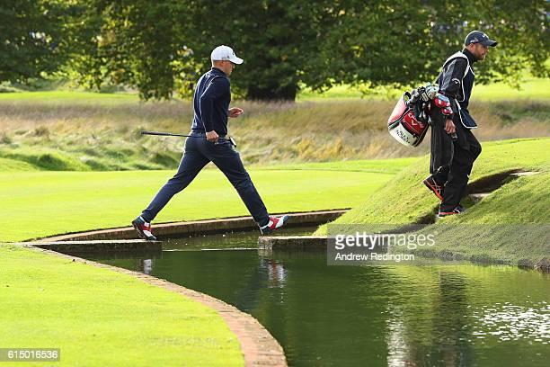 Alex Noren of Sweden crosses the water on the 13th hole during the fourth round of the British Masters at The Grove on October 16 2016 in Watford...