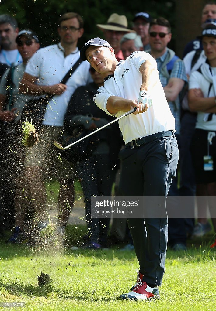 Alex Noren of Sweden hits his 2nd shot on the 16th hole during day one of the BMW PGA Championship at Wentworth on May 26, 2016 in Virginia Water, England.