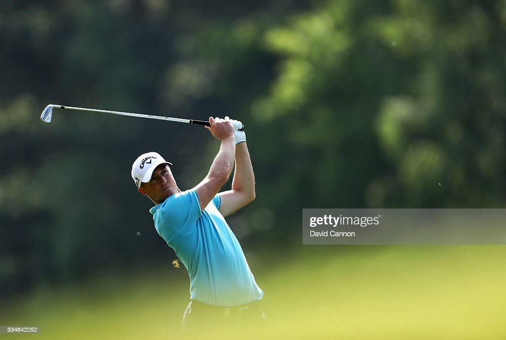 Alex Noren of Sweden hits his 2nd shot on the 9th hole during day two of the BMW PGA Championship at Wentworth on May 27, 2016 in Virginia Water, England.