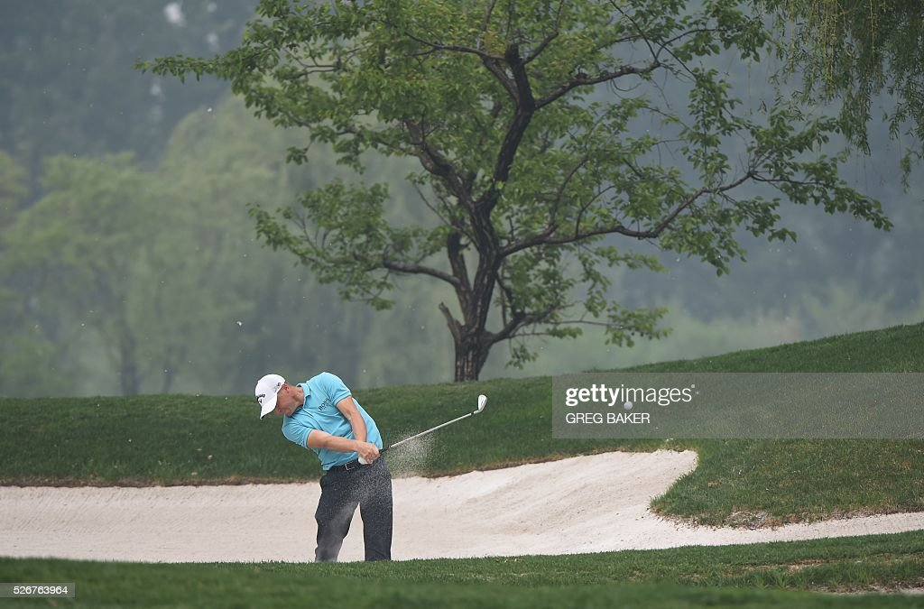 Alex Noren of Sweden hits out of a bunker during the final round of the Volvo China Open golf tournament in Beijing on May 1, 2016. / AFP / GREG