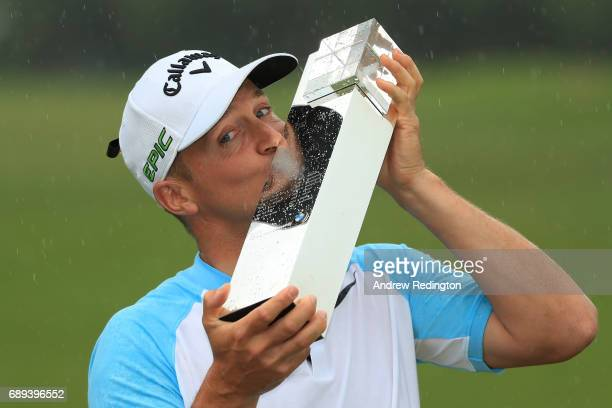 Alex Noren of Sweden kisses the trophy as he celebrates victory after the final round on day four of the BMW PGA Championship at Wentworth on May 28...