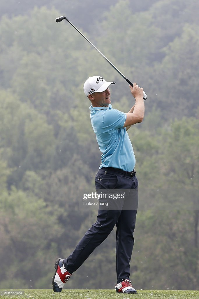 Alex Noren of Sweden plays a shot during the final round of the Volvo China open at Topwin Golf and Country Club on May 1, 2016 in Beijing, China.