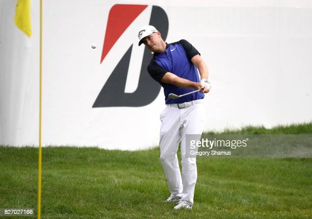 Alex Noren of Sweden plays a shot on to the ninth green during the final round of the World Golf Championships Bridgestone Invitational at Firestone...