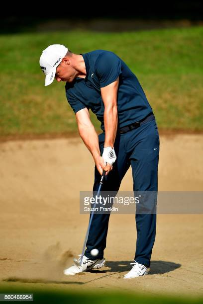 Alex Noren of Sweden plays a shot out of the bunker on Day One of the Italian Open at Golf Club Milano Parco Reale di Monza on October 12 2017 in...