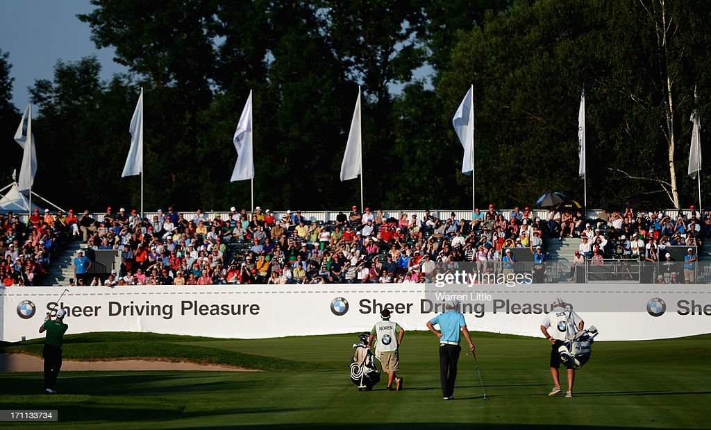 Alex Noren of Sweden plays his second shot into the 18th green during the third round of the BMW International Open at Golfclub Munchen Eichenried on June 22, 2013 in Munich, Germany.