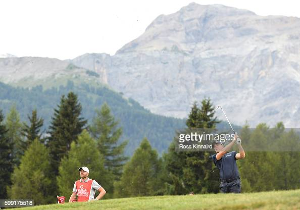 Alex Noren of Sweden plays his second shot on the 12th hole during the final round of the Omega European Masters at CranssurSierre Golf Club on...