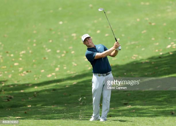 Alex Noren of Sweden plays his second shot on the par 4 eighth hole during the third round of the 2017 PGA Championship at Quail Hollow on August 12...