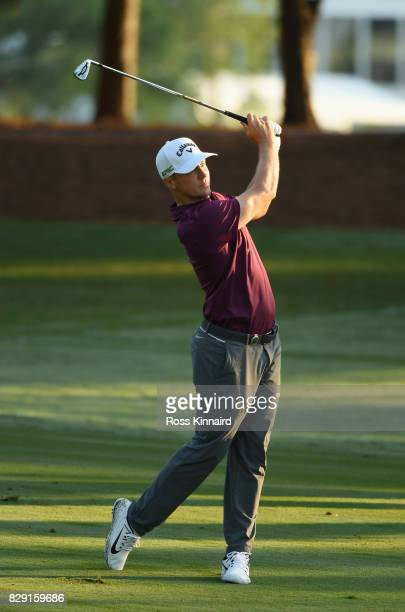 Alex Noren of Sweden plays his third shot on the 10th hole during the first round of the 2017 PGA Championship at Quail Hollow Club on August 10 2017...