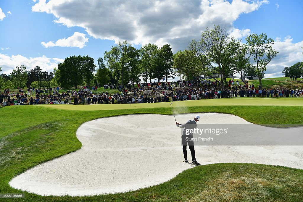 Alex Noren of Sweden plays out of a bunker on the 9th hole during the final round on day four of the Nordea Masters at Bro Hof Slott Golf Club on...