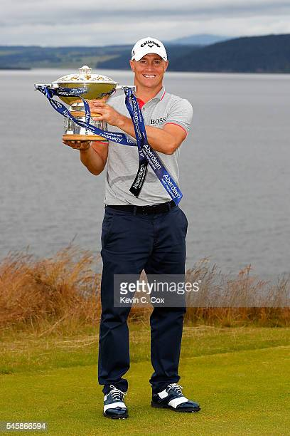 Alex Noren of Sweden poses with the trophy after claiming a one shot victory during the final round of the AAM Scottish Open at Castle Stuart Golf...