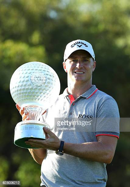 Alex Noren of Sweden poses with the trophy after his victory during day four of the Nedbank Golf Challenge at Gary Player CC on November 13 2016 in...