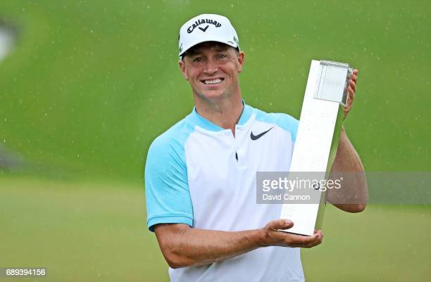 Alex Noren of Sweden poses with the trophy after his win during the final round of the 2017 BMW PGA Championship on the West Course at Wentworth on...
