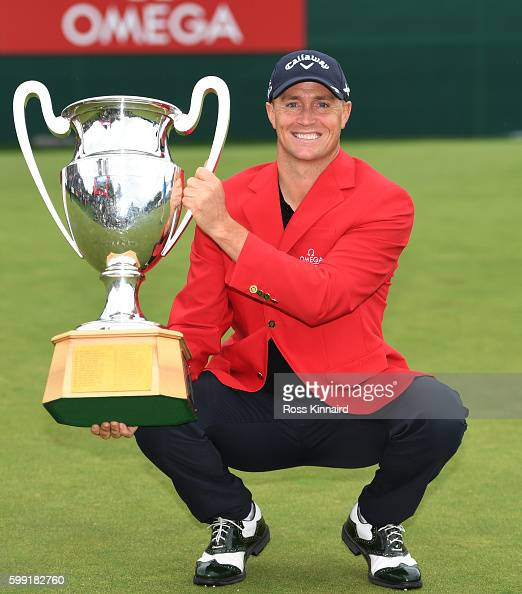 Alex Noren of Sweden poses with the trophy folowing his victory during the final round of the Omega European Masters at CranssurSierre Golf Club on...