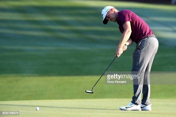Alex Noren of Sweden putts on the 10th green during the first round of the 2017 PGA Championship at Quail Hollow Club on August 10 2017 in Charlotte...