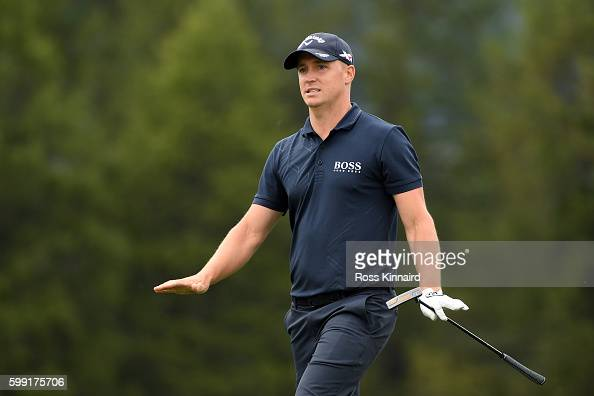 Alex Noren of Sweden reacts after playing his second shot on the 12th hole during the final round of the Omega European Masters at CranssurSierre...
