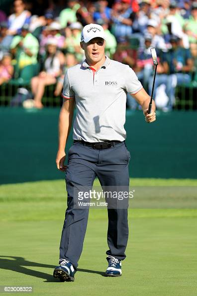 Alex Noren of Sweden reacts to holing the winning putt on the 18th green during day four of the Nedbank Golf Challenge at Gary Player CC on November...