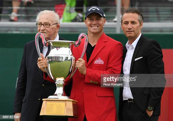Alex Noren of Sweden receives the trophy following his victory during the final round of the Omega European Masters at CranssurSierre Golf Club on...