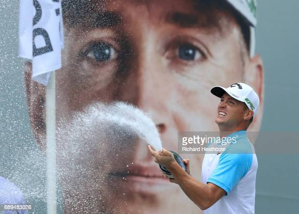 Alex Noren of Sweden sprays champagne after winning the BMW PGA Championship at Wentworth on May 28 2017 in Virginia Water England