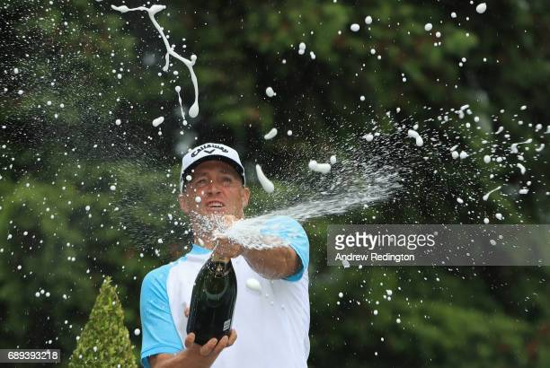 Alex Noren of Sweden sprays champagne as he celebrates victory after the final round on day four of the BMW PGA Championship at Wentworth on May 28...