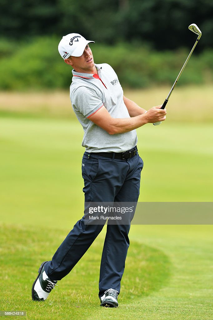 Alex Noren of Sweden takes his second shot on hole 14 on day three of the Aberdeen Asset Management Paul Lawrie Matchplay at Archerfield Links Golf...